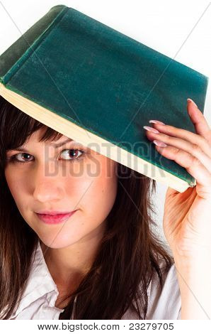 Young Girl And Her Book Against White Background