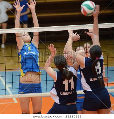 KAPOSVAR, HUNGARY - APRIL 24: Zsofia Harmath (3) blocks the ball at the Hungarian NB I. League woman volleyball game Kaposvar (blue) vs Ujbuda (black), April 24, 2011 in Kaposvar, Hungary.