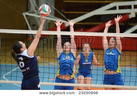 KAPOSVAR, HUNGARY - APRIL 24: Barbara Balajcza (R) blocks the ball at the Hungarian NB I. League woman volleyball game Kaposvar (blue) vs Ujbuda (black), April 24, 2011 in Kaposvar, Hungary.