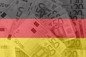 Flag Of Germany With Transparent Euro Banknotes In Background
