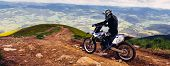 Carpathian Mountains In Ukraine.man Rides A Motorcycle In The Mountains. Mountain Range In Summer Gr poster
