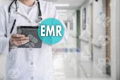 Electronic Medical Records. Emr On The Touch Screen With Medicine Icons On The Background Blur Docto poster