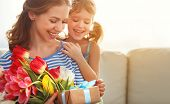 Happy Mothers Day! Child Daughter   Gives Mother A Bouquet Of Flowers To Tulips And Gift poster