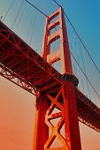 stock photo of golden gate bridge  - golden gate tower in sunset - JPG