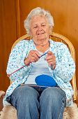 stock photo of old lady  - Portrait of a senior woman in rocking chair - JPG