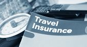 image of passport cover  - Travel insurance concept with luggage scale and information leaflet