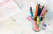 picture of dessin  - Colored pencils in a glass on a child - JPG