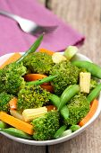 stock photo of mange-toute  - Broccoli salad with carrot  - JPG