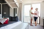 Senior Couple Arriving At Summer Vacation Rental poster