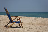 stock photo of spring break  - Empty chair on the beach the owner nowhere to be found - JPG