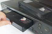 Vhs Videocassette Is Put Into The Video Recorder To Watch The Video, Another Video Cassette Is On Th poster