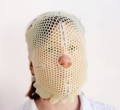 stock photo of thermoplastics  - Female patient wearing a custom made Thermoplastic Radiotherapy Mask - JPG