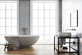 Luxury Bathroom Interior Idea. A Wooden Floor, A Large Window And A White Bathtub And Sink. Concrete poster