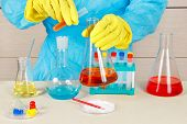 Laboratory Assistant In Rubber Gloves Doing Chemical Analysis In The Laboratory poster
