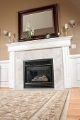 stock photo of cozy hearth  - A unique view of a living room fireplace in a upscale home - JPG