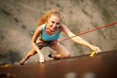 Strong Woman And Business Success Concept. Young Caucasian Strong Woman Practicing Climbing On Artif poster