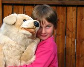 Little Girl With A Big Toy Dog poster