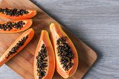 Papaya On Wooden Background. Healthy Food, Ripe Exotic Fruits. The Concept Of Vegetarianism poster