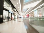 Shopping Mall Blur Background With Bokeh. Blurred Hall Of Shopping Mall With Customers As Background poster