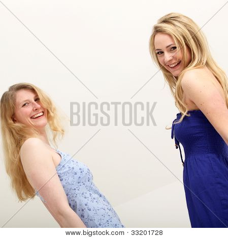 Two Vivacious Female Friends Laughing