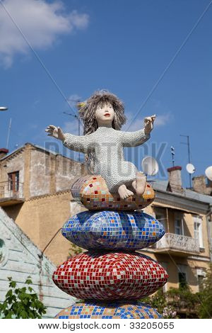 Child On Pillow Statue