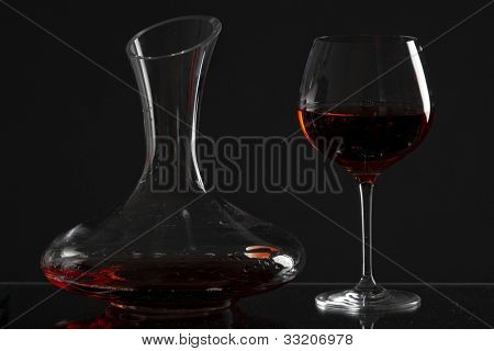 wine glass and carafe with red wine