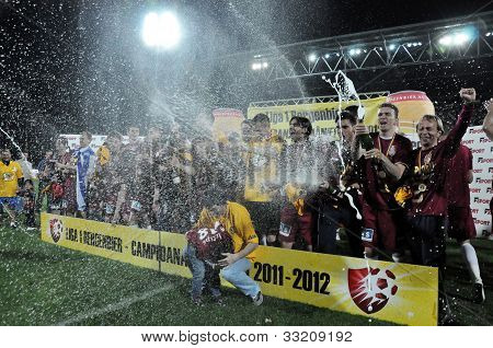 Soccer players celebrating the league title with champagne