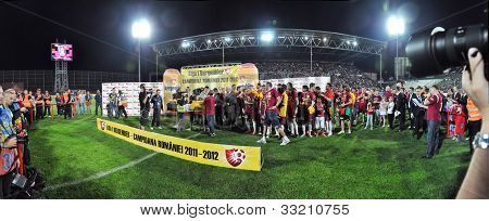 Panorama with soccer players celebrating the new league title