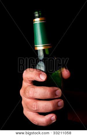 Male Hand Holding Beer Bottle