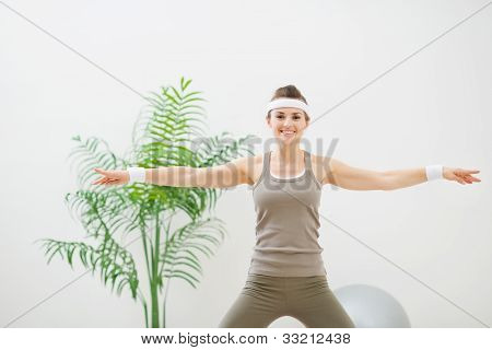 Healthy Woman Making Gymnastics