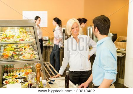 Office people at cafeteria chatting hold serving tray canteen self-service