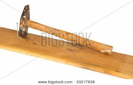 Hammer, nail and wooden board