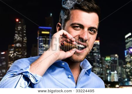 Confident man smoking a cigar