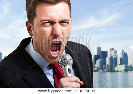 Man screaming loud in a microphone