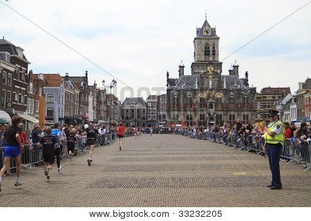 Runners Passing City Hall In Historic Delft