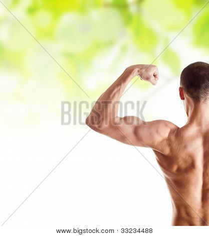 Man Showing His Biceps Over Green