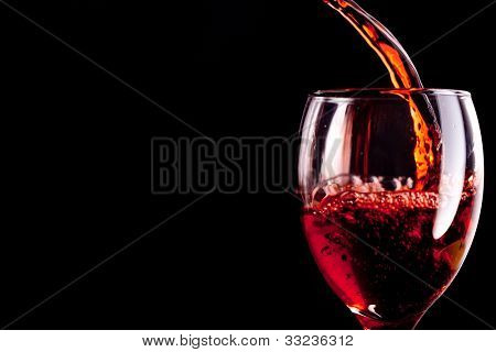 Stemware being filled with wine