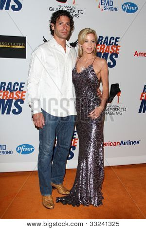 LOS ANGELES - MAY 18:  Dimitri Charalambopoulos, Camille Grammer arrives at the 19th Annual Race to Erase MS gala at Century Plaza Hotel on May 18, 2012 in Century City, CA