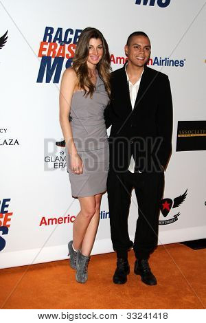 LOS ANGELES - MAY 18:  Cora Skinner, Evan Ross arrives at the 19th Annual Race to Erase MS gala at Century Plaza Hotel on May 18, 2012 in Century City, CA