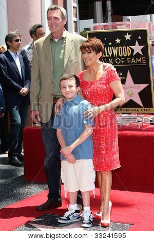 LOS ANGELES - MAY 22:  Patricia Heaton, Neil Flynn, Atticus Shaffer at the Hollywood WOF Ceremony for Patrica Heaton at Hollywood Boulevard on May 22, 2012 in Los Angeles, CA