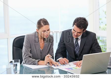 Colleagues working together  in an office