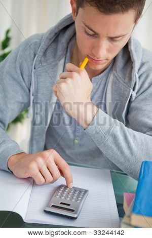 Student using a calculator while doing his homework