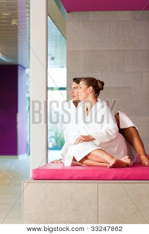 Young couple in bathrobe in Spa, they presumably having their honeymoon