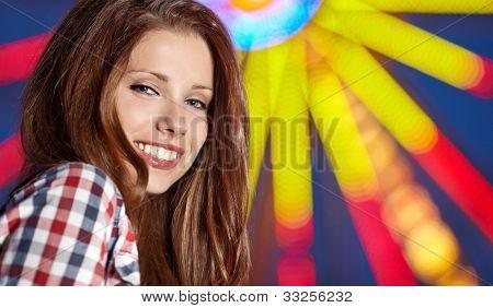 Woman next  Amusement park at night