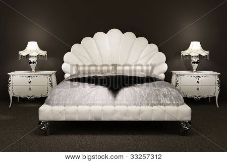 Modern Bed With  Furry Bedspread And  Lamp On Thebedside Table. Luxurious Furniture In Interior Of A