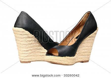 A pair of women's buskin shoes isolated over white with clipping path