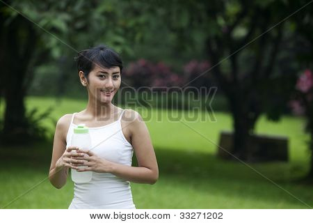 Healthy Woman With Bottle Of Water