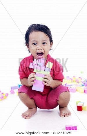Little Girl Plays with blocks