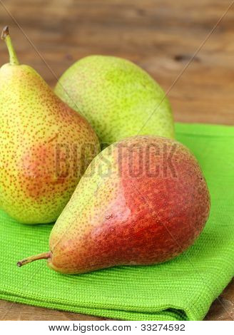 three ripe juicy pear on a wooden table