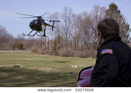 NEWTON, NJ - APR 9: A helicopter team returns from preparing power lines to be replaced in Newton, NJ on April 9, 2011.